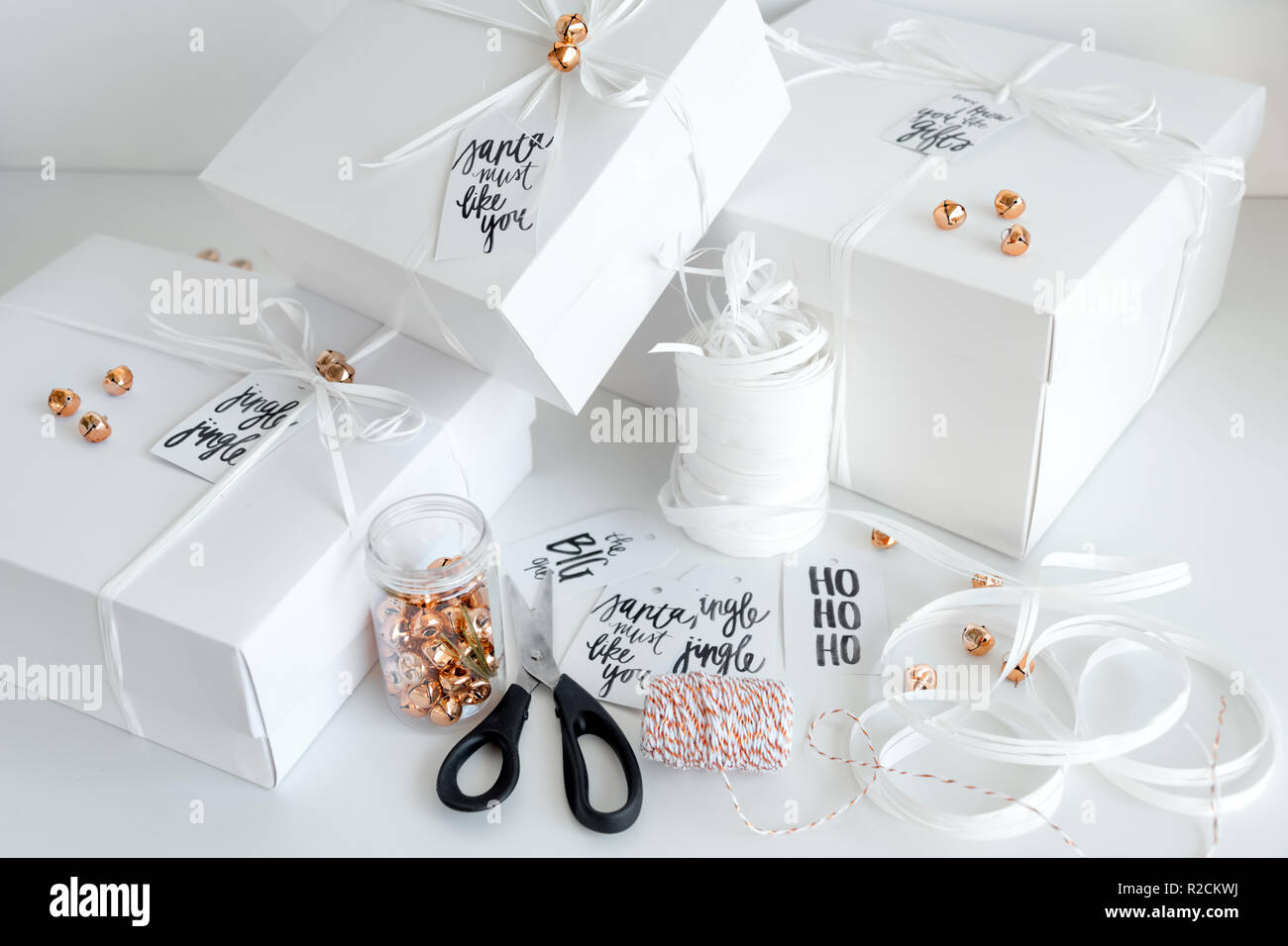 New Year Gifts White Boxes On Light Background With Winter Holidays