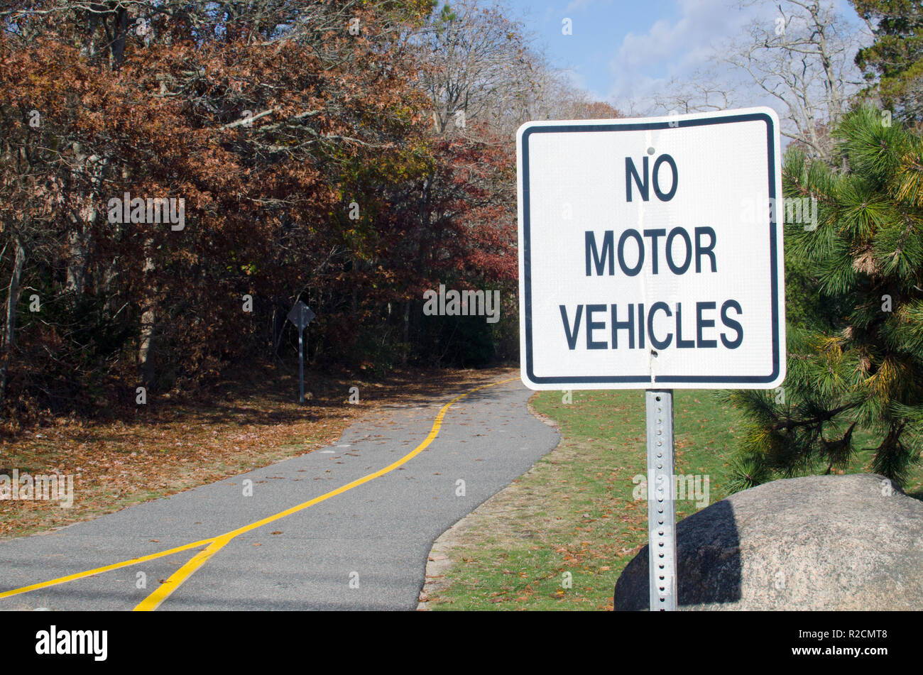 No Motor Vehicles sign on the paved Shining Sea Bikeway Falmouth, Cape Cod bike and walking path in late autumn - Stock Image