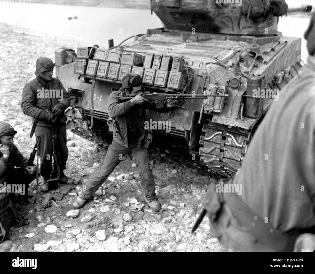 Korean War, 1951: A US soldier behind an M4A3E8 Sherman tank