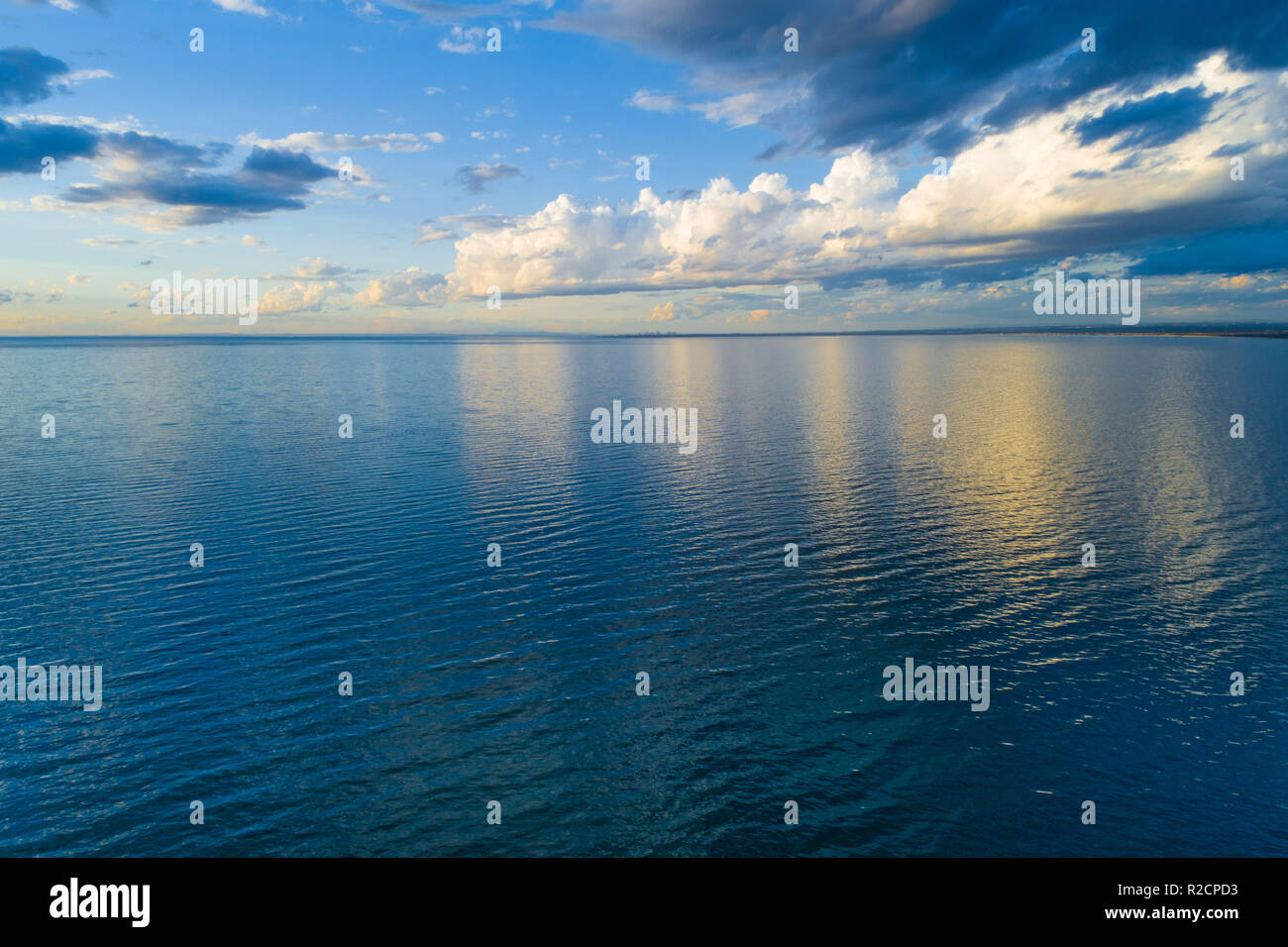 Clouds over water at sunset - aerial view - Stock Image