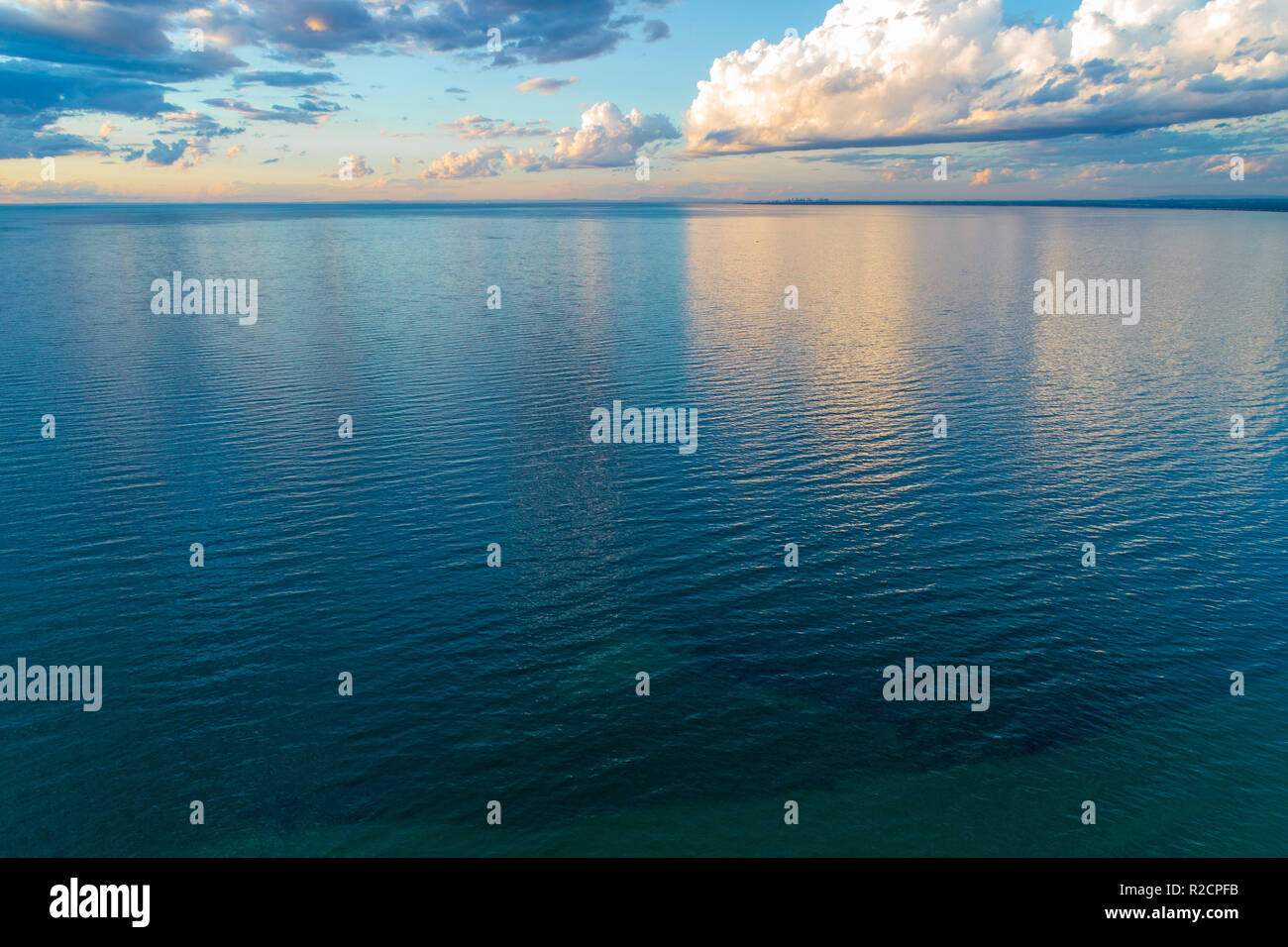 Minimalist aerial seascape - clouds over water - Stock Image
