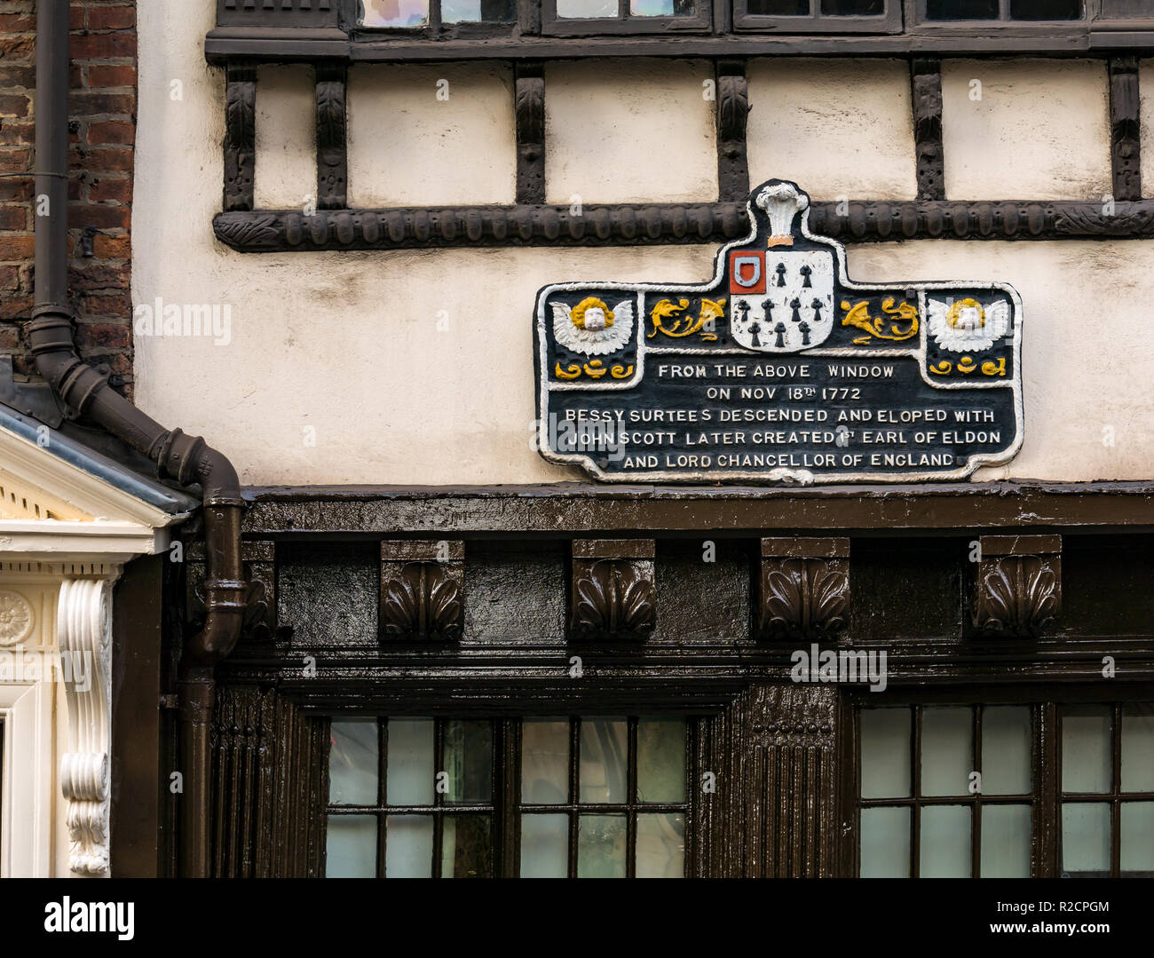 Wooden sign about Bessy Surtees elopement with John Scott, historic building, Newcastle Upon Tyne, England, UK - Stock Image