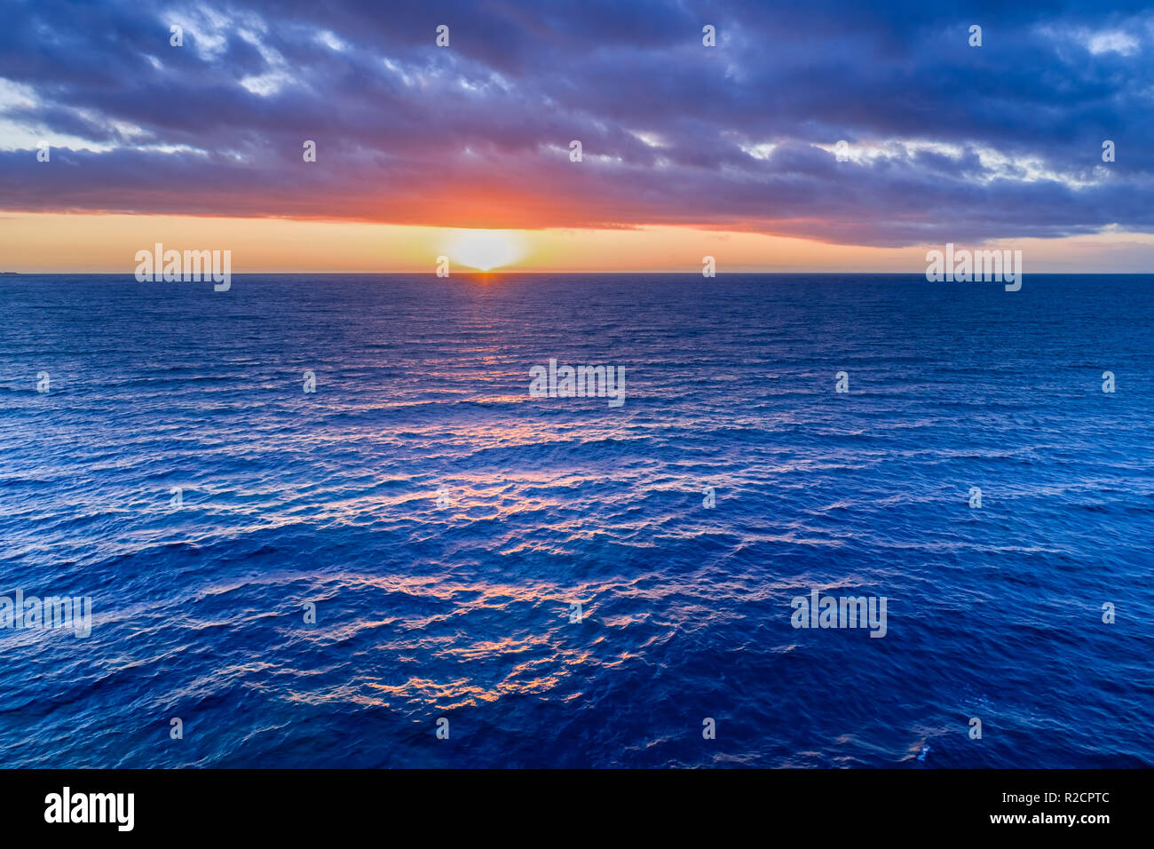 Nothing but sunset over water - aerial view - Stock Image