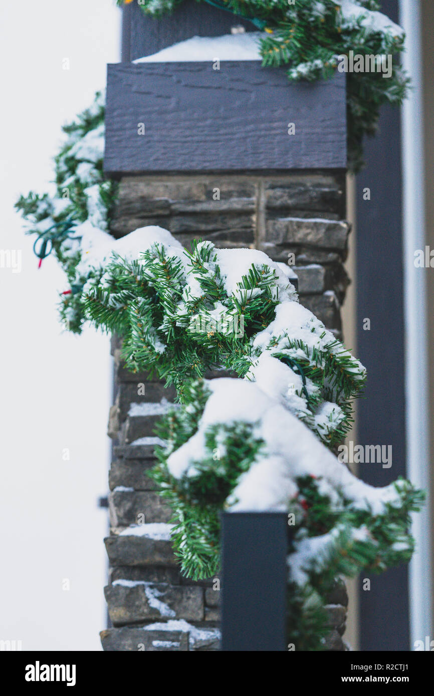 Christmas decorations outside a house in winter - Stock Image