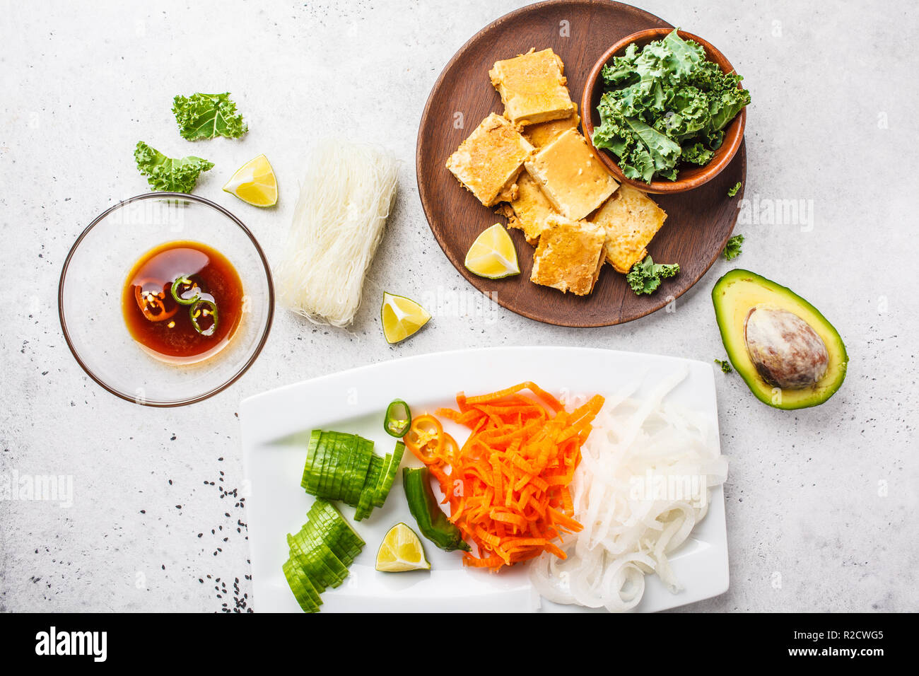 Vegan bun cha salad bowl with sticky tofu, rice noodles and vegetables, flat lay, top view. Plant based diet concept. Stock Photo