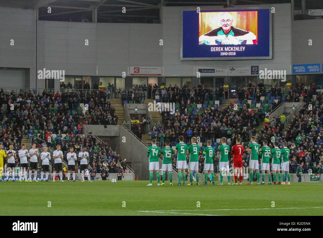 Windsor Park, Belfast, Northern Ireland. 18 November 2018. UEFA Nations League Group B3 - Northern Ireland (green) v Austria. Action from this evening's game. Both teams join in a minute's applause in memory of former Northern Ireland kitman Derek McKinley who died last week. Derek had been kitman for 230 games over 30 years and six managers. Credit: David Hunter/Alamy Live News. - Stock Image