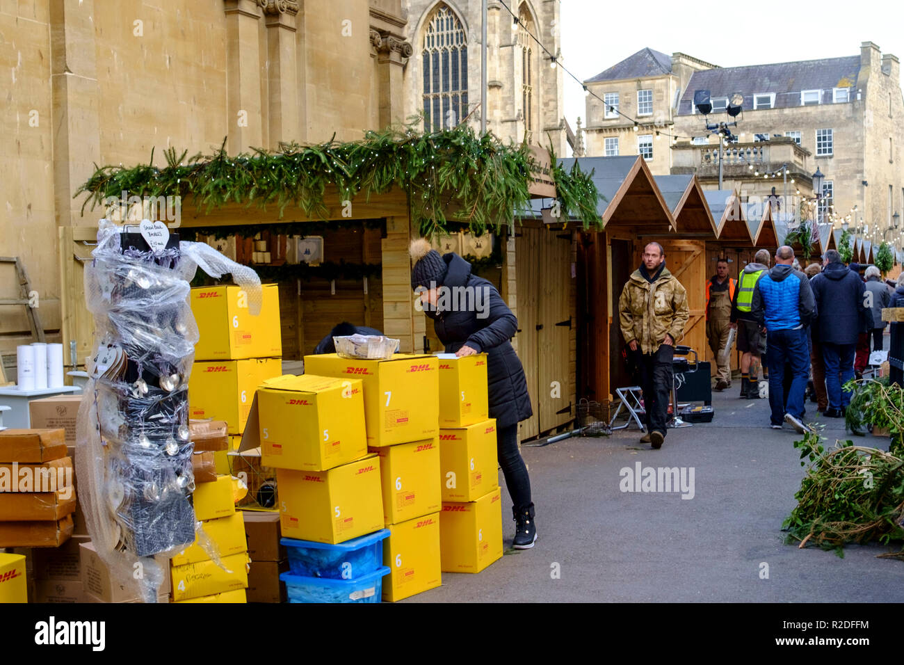 Bath, UK. 19th Nov 2018. Stalls are being erected and goods unpacked ahead of this years christmas market in Bath. Each year the abbey courtyard and surrounding streets are taken over for the christmas market. The market starts on the 22nd November until 9th Dec. Credit: Mr Standfast/Alamy Live News - Stock Image