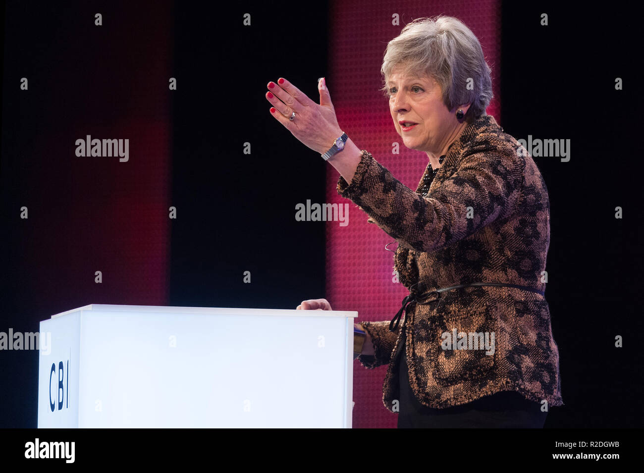 London, Britain. 19th Nov, 2018. British Prime Minister Theresa May delivers a keynote speech at the annual conference of the Confederation of British Industry (CBI) in London, Britain, on Nov. 19, 2018. Theresa May on Monday enlisted British business leaders to back her much-criticized Brexit deal, insisting that she would not make any change to the draft divorce agreement between London and Brussels. Credit: Ray Tang/Xinhua/Alamy Live News - Stock Image