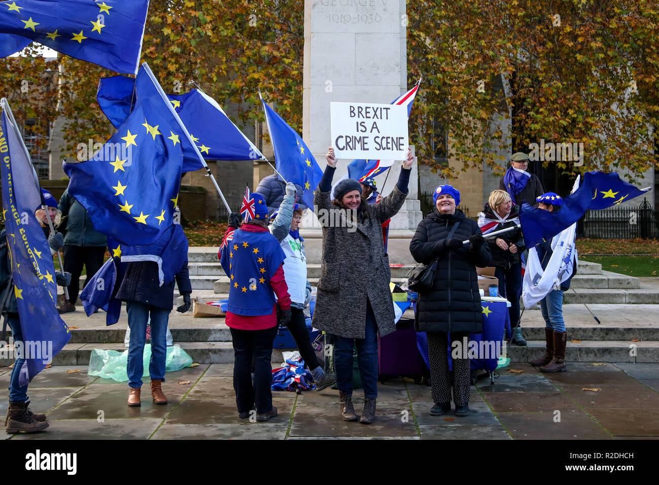 London, UK. 19th Nov, 2018. Pro-EU protesters are seen holding a placard and flags during the protest.Pro-EU protesters from SODEM (Stand in Defiance European Movement) including a large dinosaur demonstrates with their placards and European Union flags outside the Palace of Westminster in central London ahead of the crucial week of Brexit negotiations as Prime Minister Theresa May prepares to meet Chief negotiator Michel Barnier later this week to discuss the withdrawal deal. Credit: Dinendra Haria/SOPA Images/ZUMA Wire/Alamy Live News - Stock Image