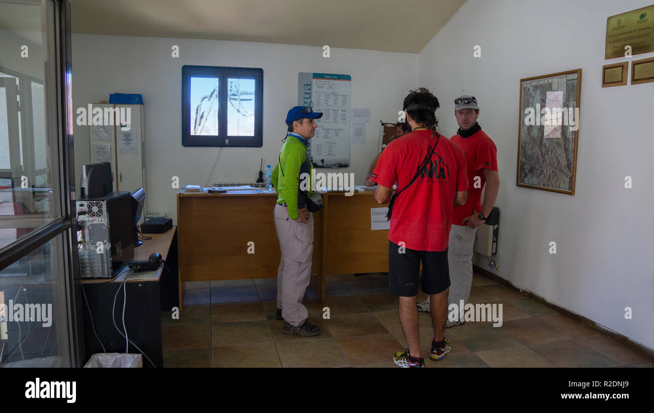 Tourists inside the administrative office of the Aconcagua Provincial Park - Stock Image
