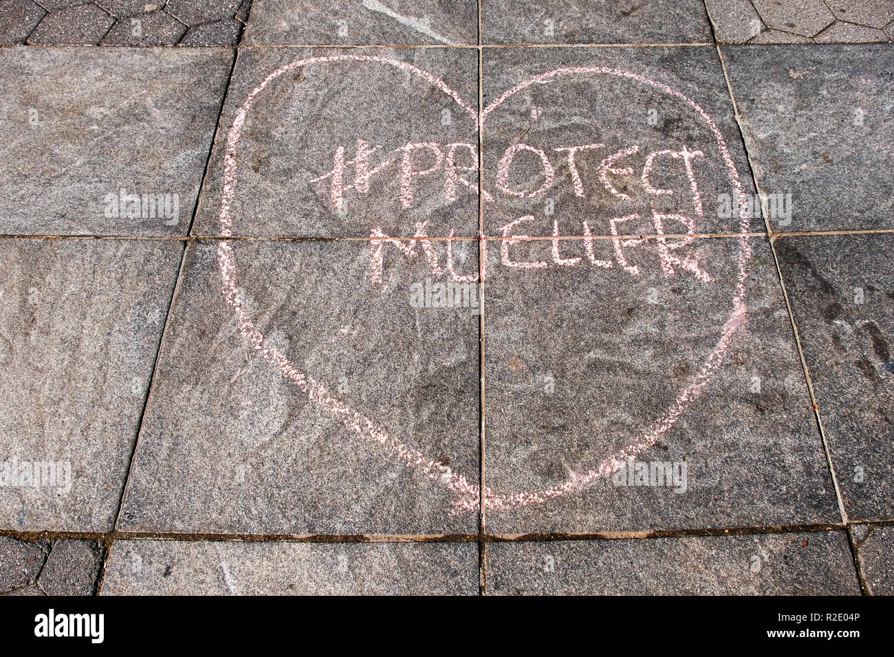 A chalk writing ion Washington Square Park urging people to protect the Robert Mueller investigation against Trump - Stock Image