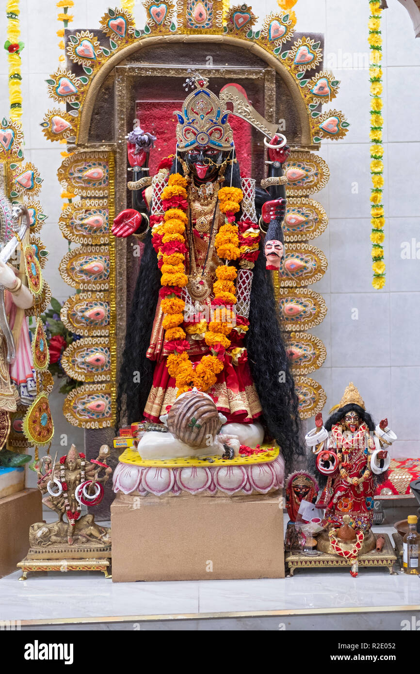 Ornate statue of the Hindu goddess Kali. At the Om Shakti Hindu temple in Flushing, Queens, New York. - Stock Image
