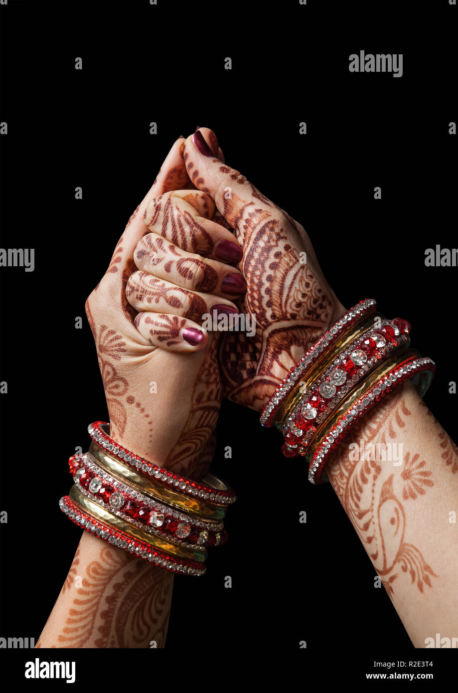 Woman hands with henna in shell mudra on black background - Stock Image