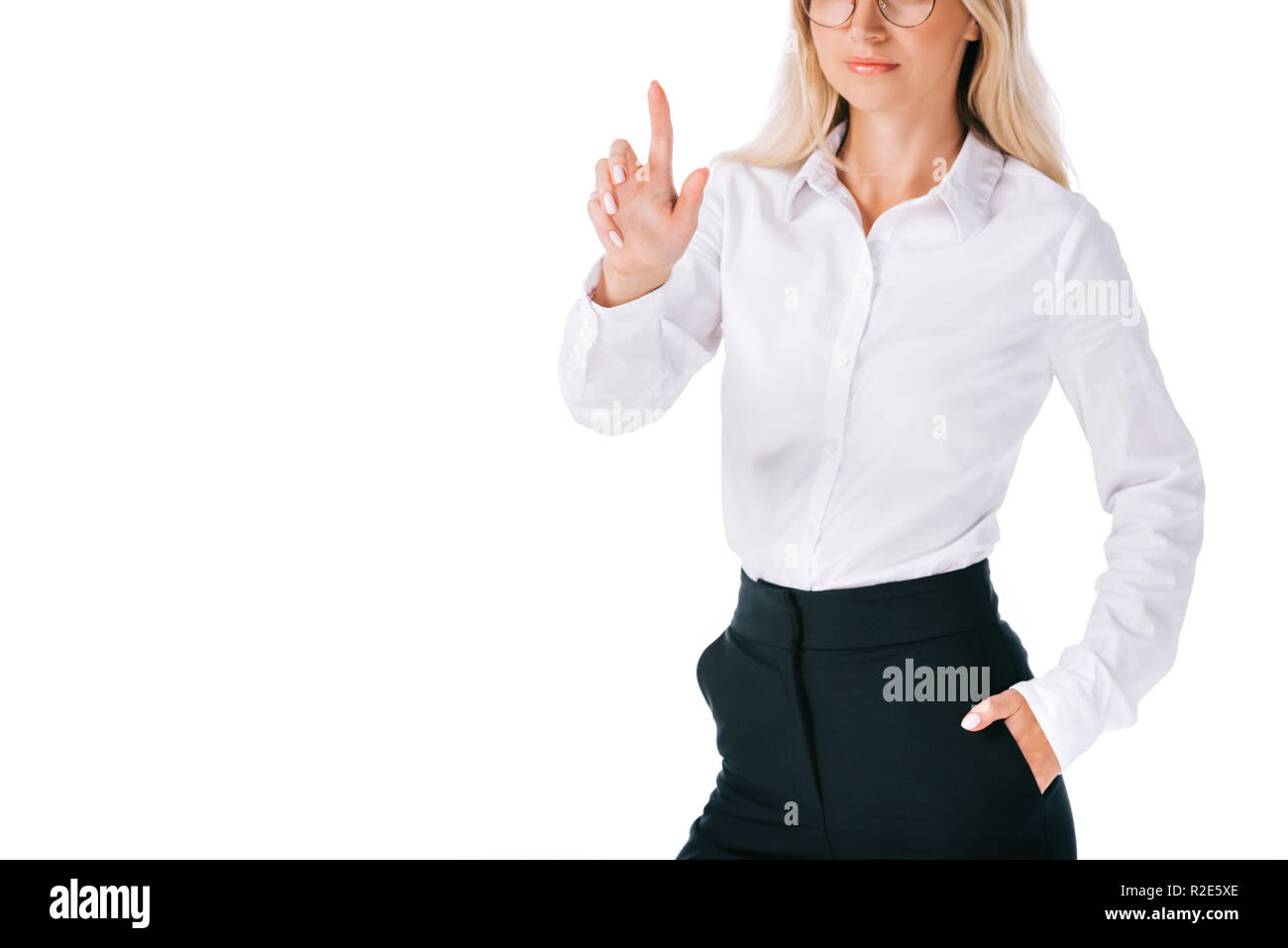 partial view of businesswoman in formal wear gesturing isolated on white - Stock Image