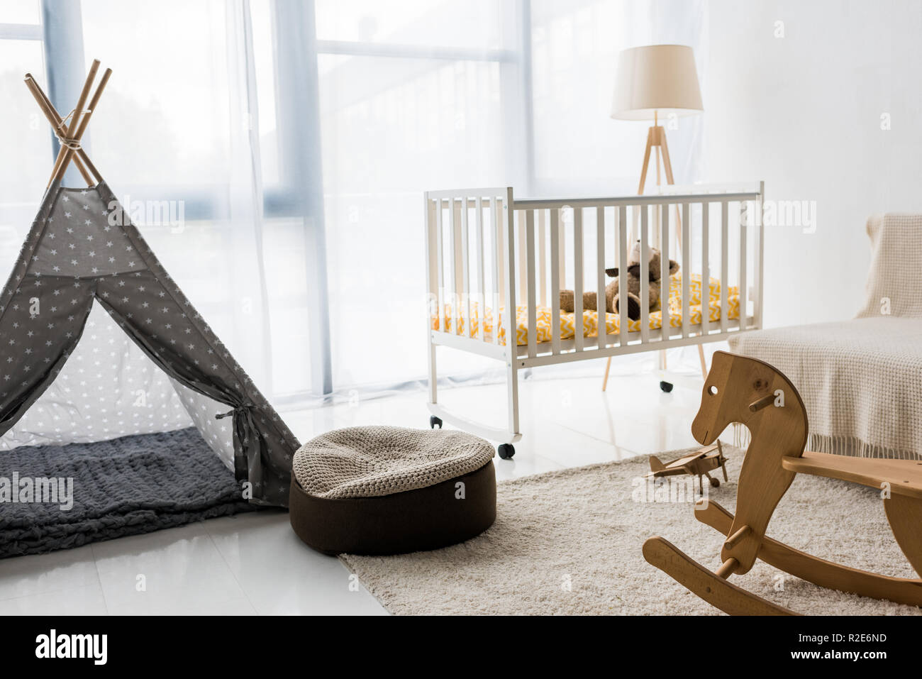 modern interior design of nursery room with bean bag chair - Stock Image
