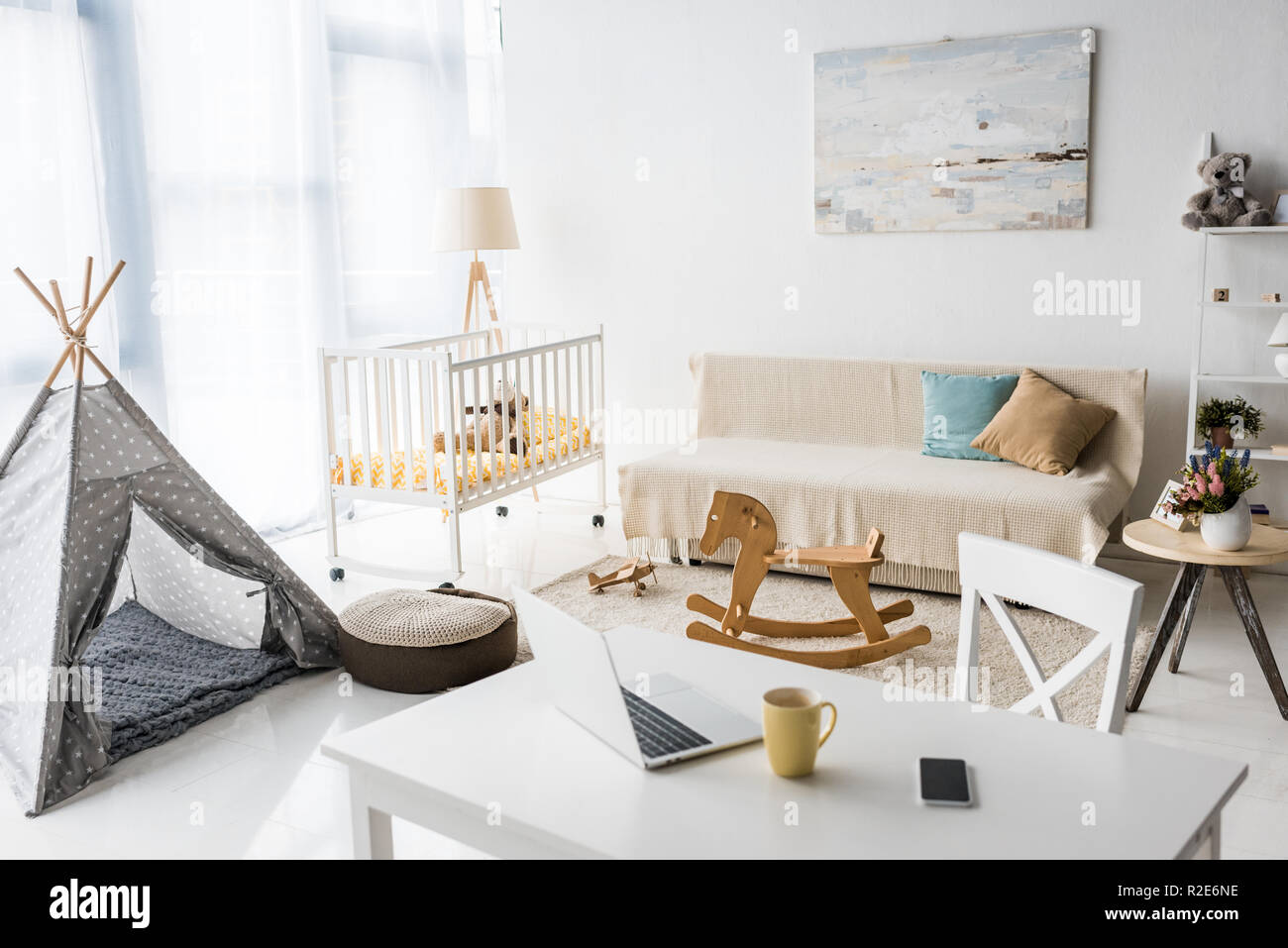 modern interior design of nursery room with baby wigwam and crib - Stock Image
