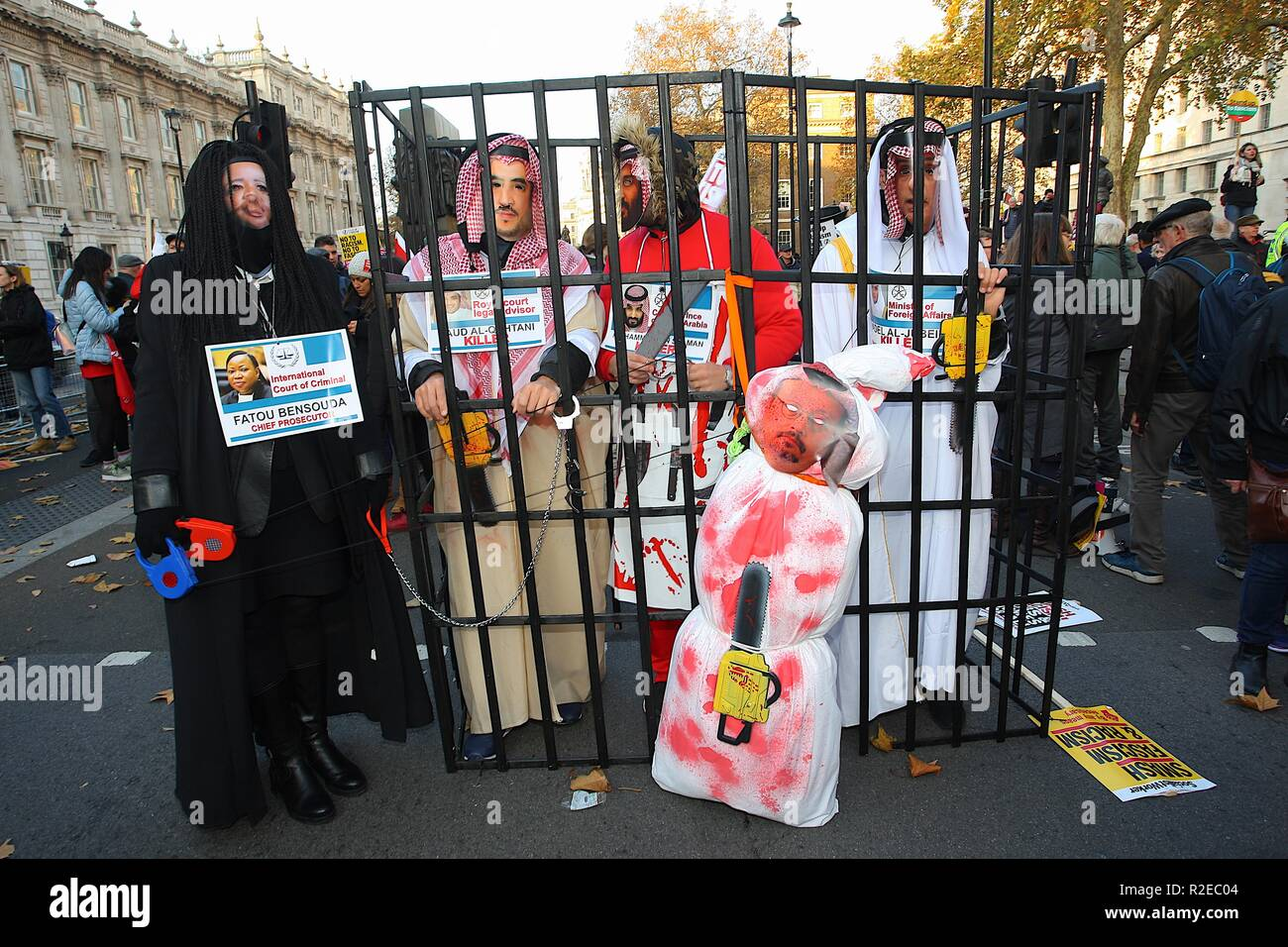 Protesters in London dress up with a cage showing those responsible for the killing of Saudi Washington post journalist Jamal Khashoggi. - Stock Image