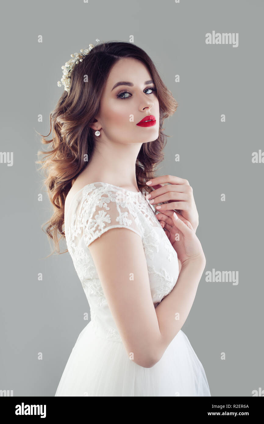 Cute Bride With Makeup And Bridal Hairstyle Wearing White Wedding
