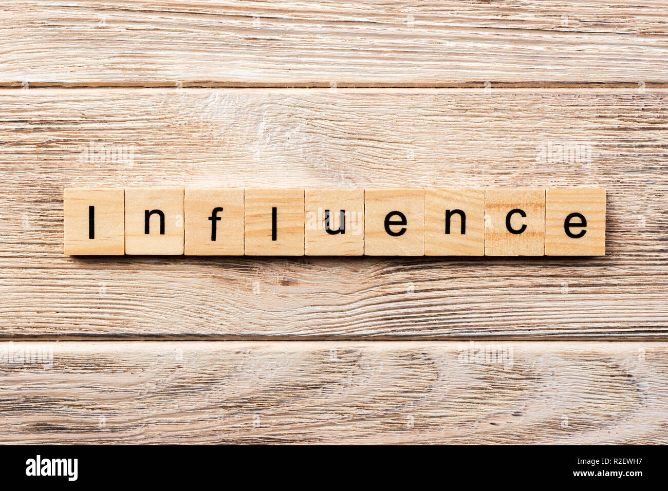 influence word written on wood block. influence text on table, concept. - Stock Image