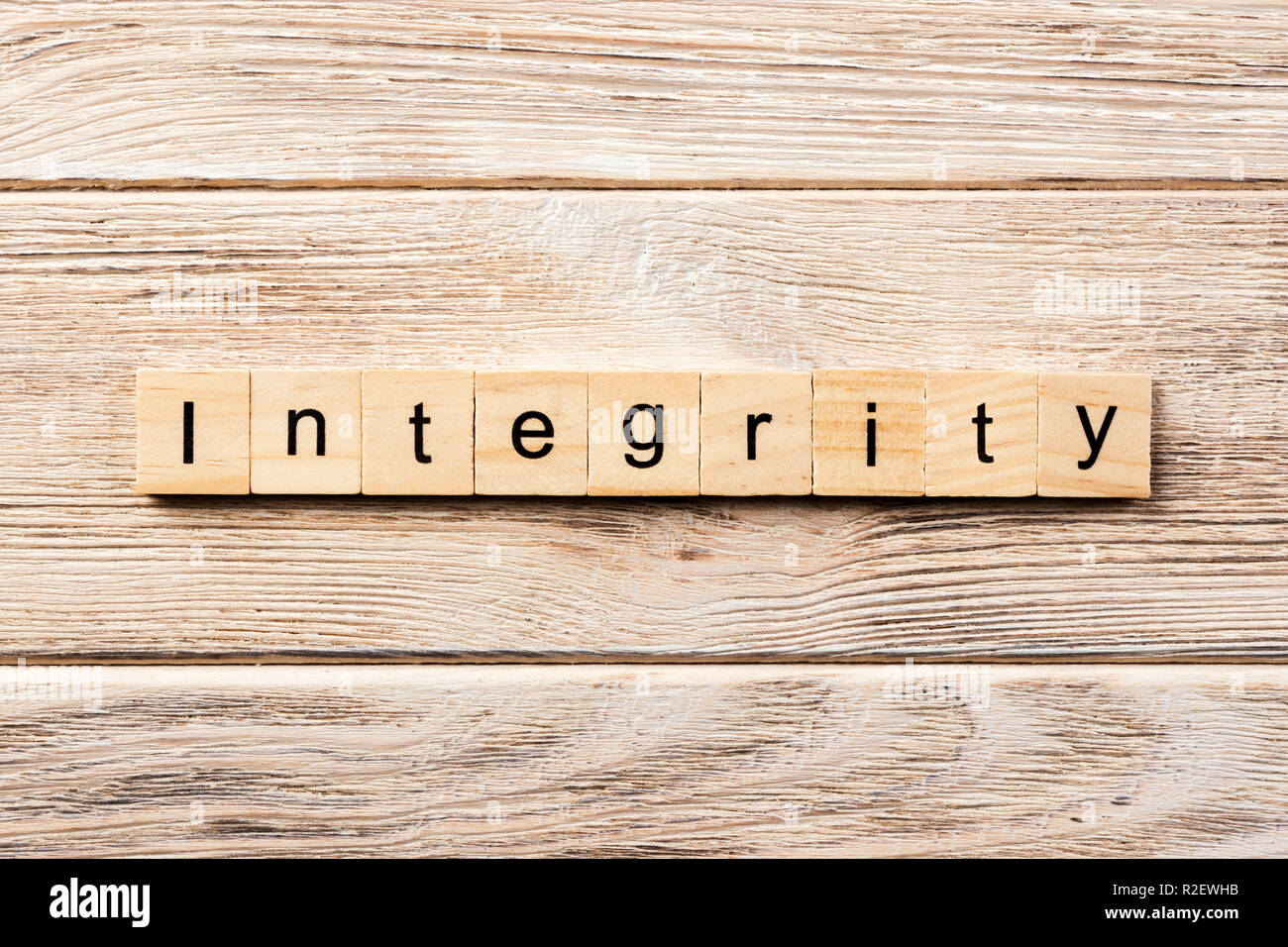 integrity word written on wood block. integrity text on table, concept. - Stock Image