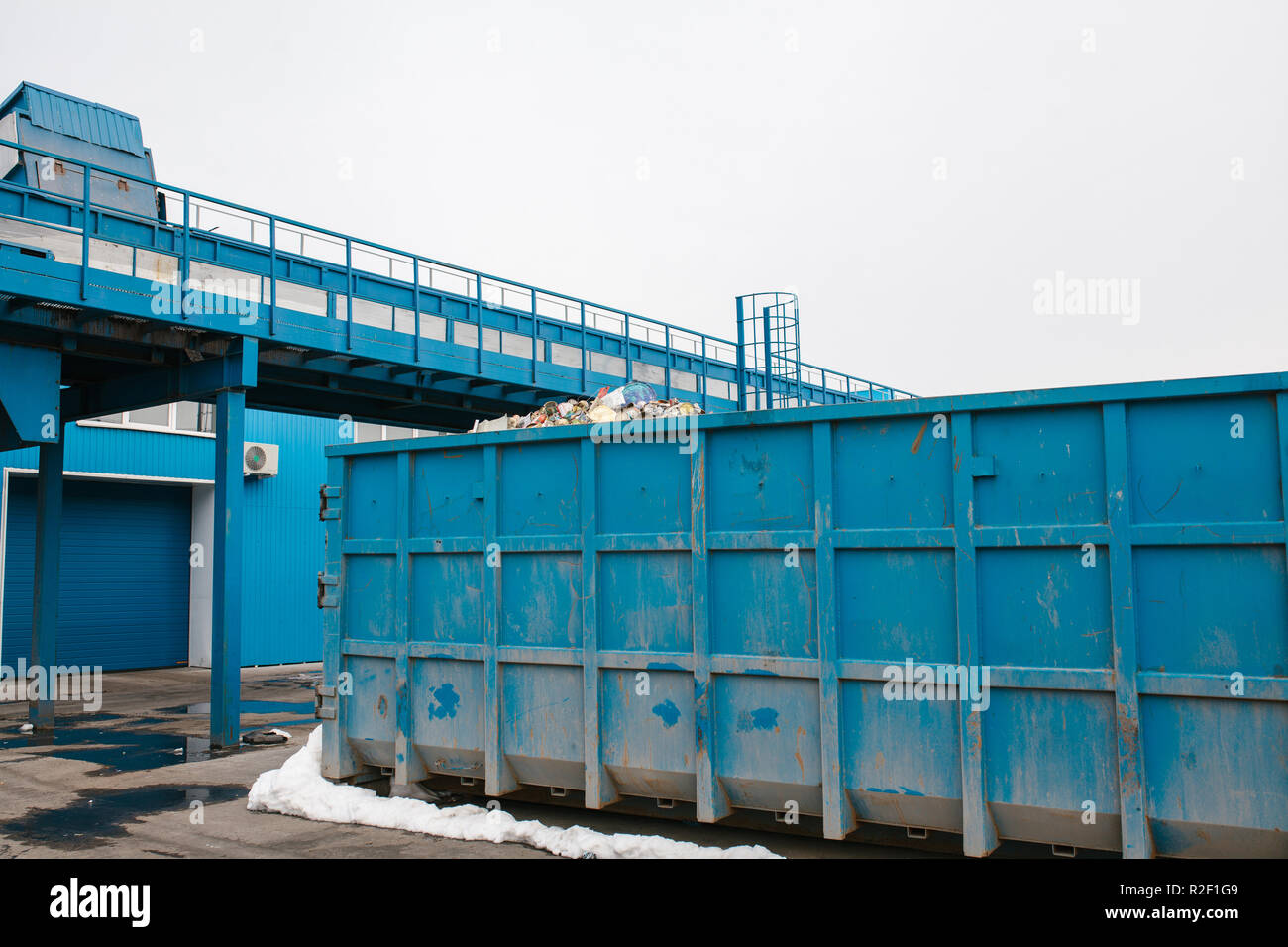 Container for waste storage at a waste processing plant for further processing and disposal. - Stock Image