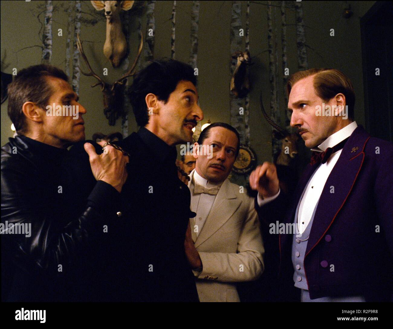 The Grand Budapest Hotel  Year : 2014 USA / Germany Director : Wes Anderson Willem Dafoe, Adrian Brody, Mathieu Amalric, Ralph Fiennes - Stock Image