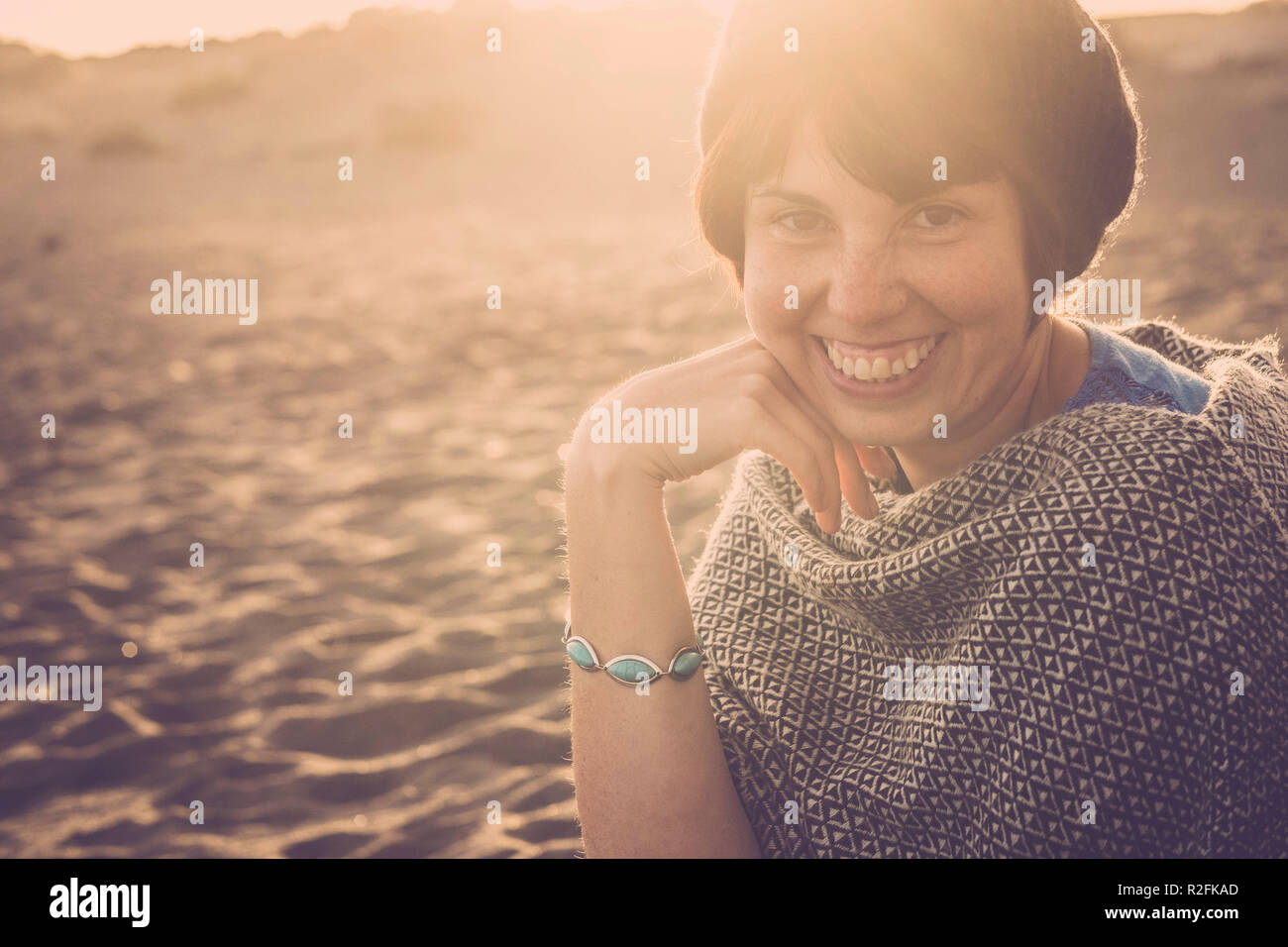 nice happy girl smile in the sunset time happy for vacation and leisure time outdoor. one person happiness travel concept with beach on the background - Stock Image