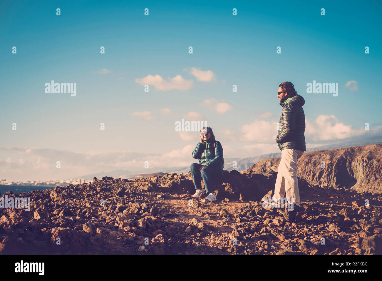 Senior mother and 45 year old son spend good time together hiking and observing the beauty that surrounds them - Stock Image