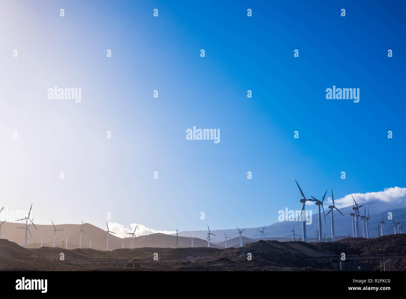 Clean blue sky in beautiful nature concept tiwh clean energy production with wind farm. Tenerife. Modernity concept - Stock Image