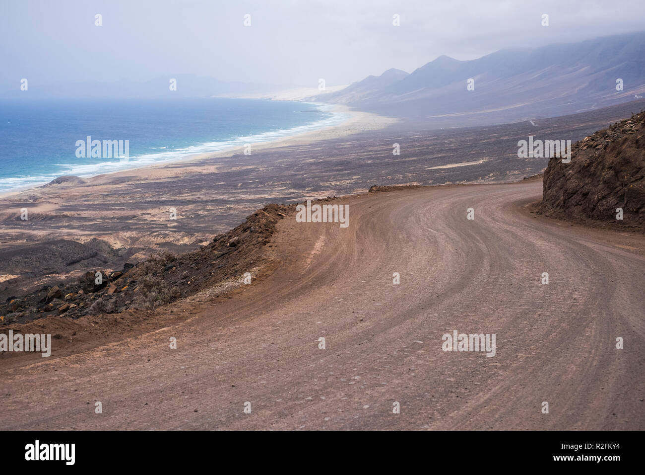 infinite wild beach with nobody there el cofete fuerteventura. paradise for surfers and backpack traveler no asphalt road just ground and adventure. timeless place to live an alternative lifestyle - Stock Image