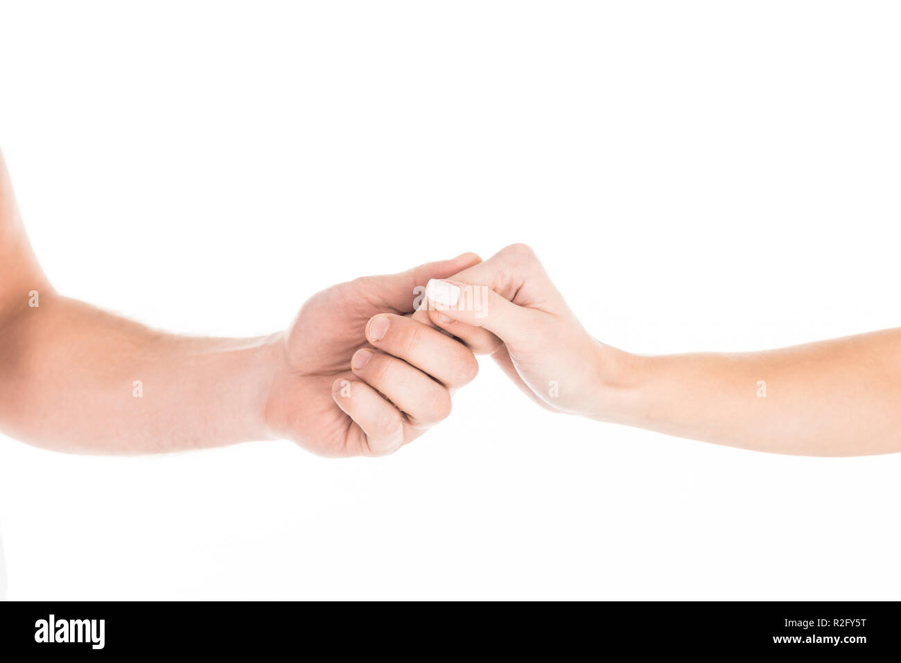Partial view of people tenderly holding hands isolated on white - Stock Image