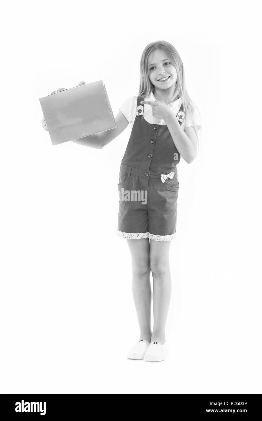 Get smart with coupons. Girl cute teenager carries shopping bag. Kid bought clothing summer sale. Loyalty program benefits. Loyalty programs remain extremely popular with consumers. Shopping discount. - Stock Image