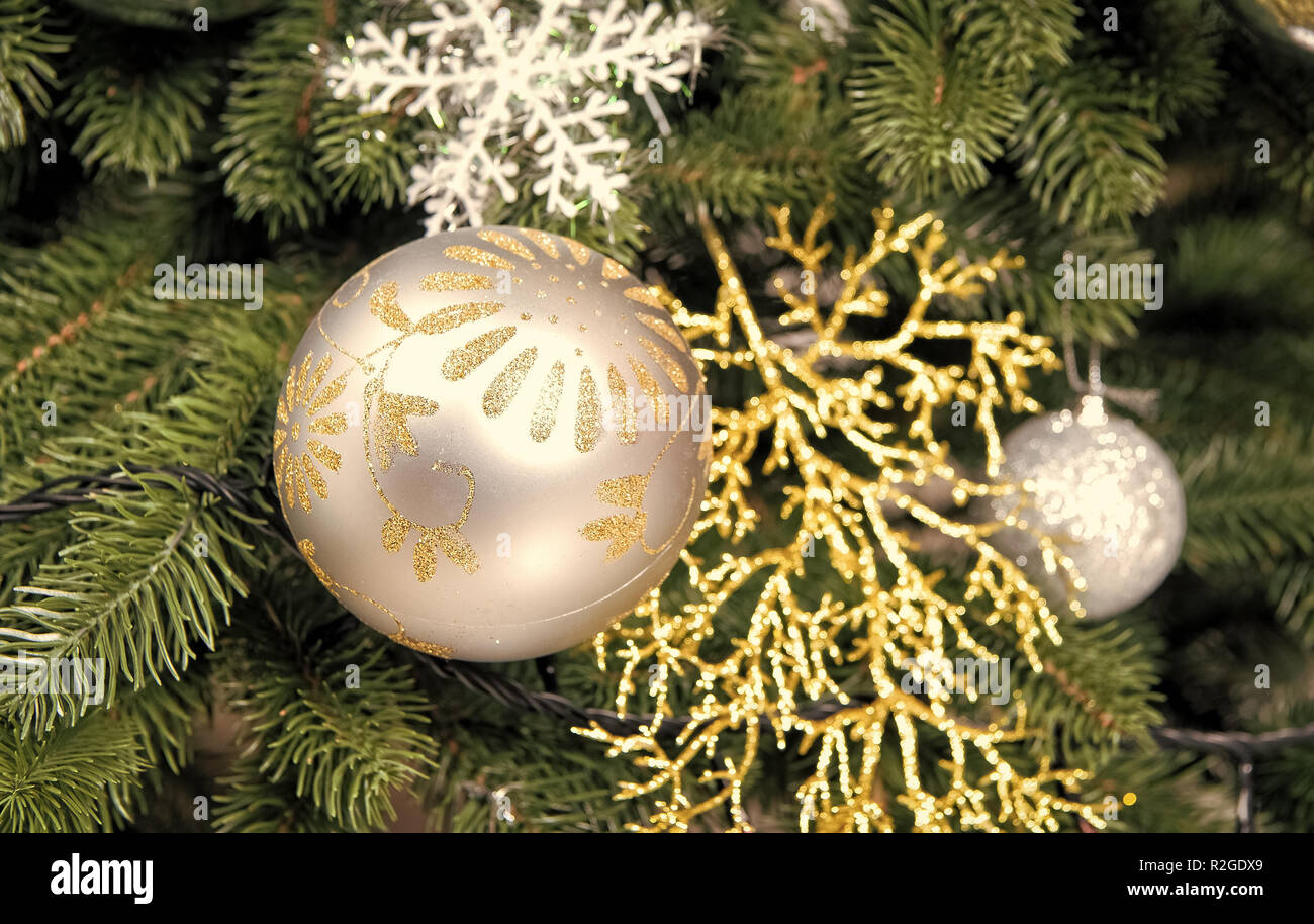 Christmas Ball Ornaments And Decorations On Green Fir Tree Branches