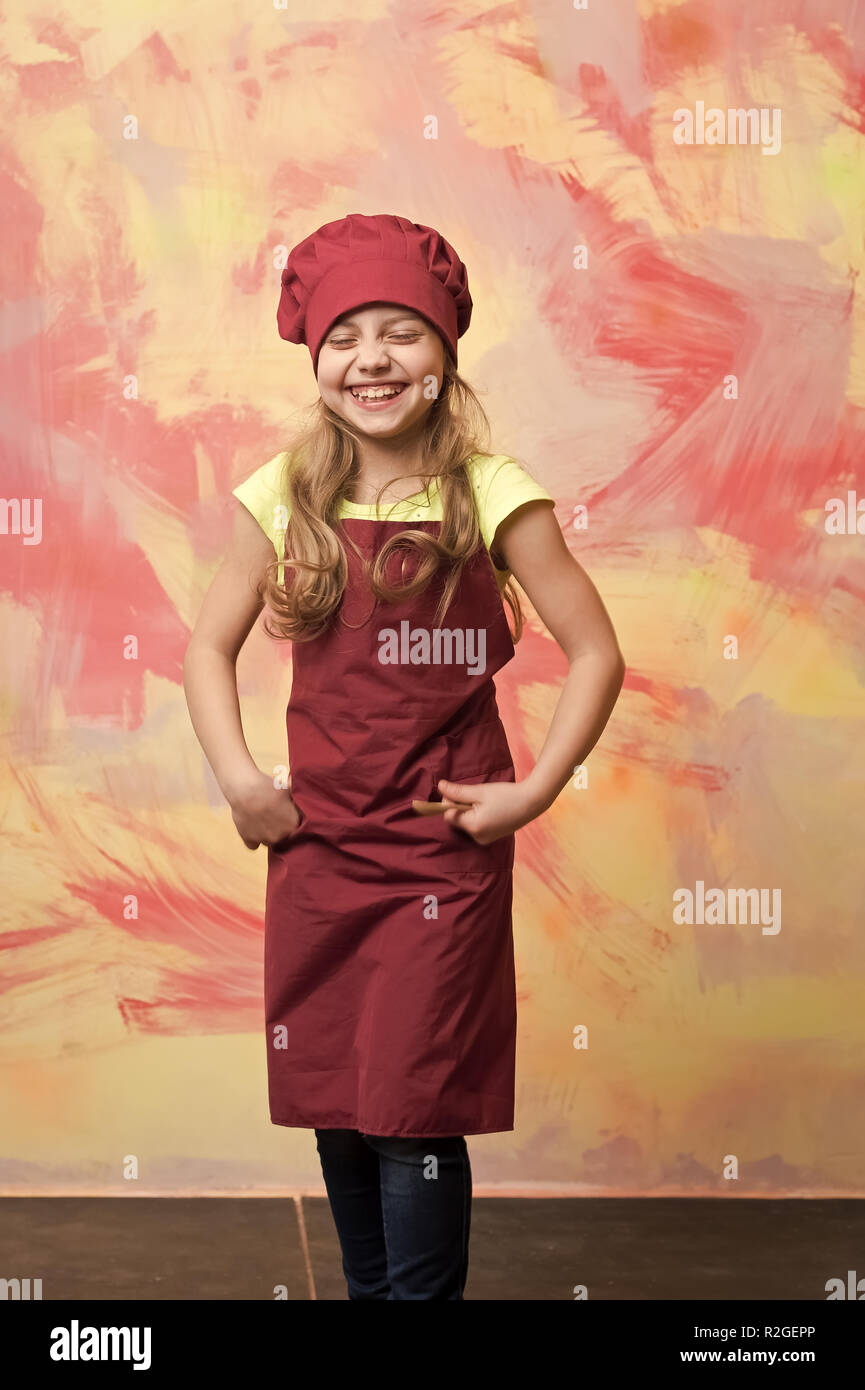 Happy Girl Cook Smiling In Chef Hat And Apron On Abstract Colorful