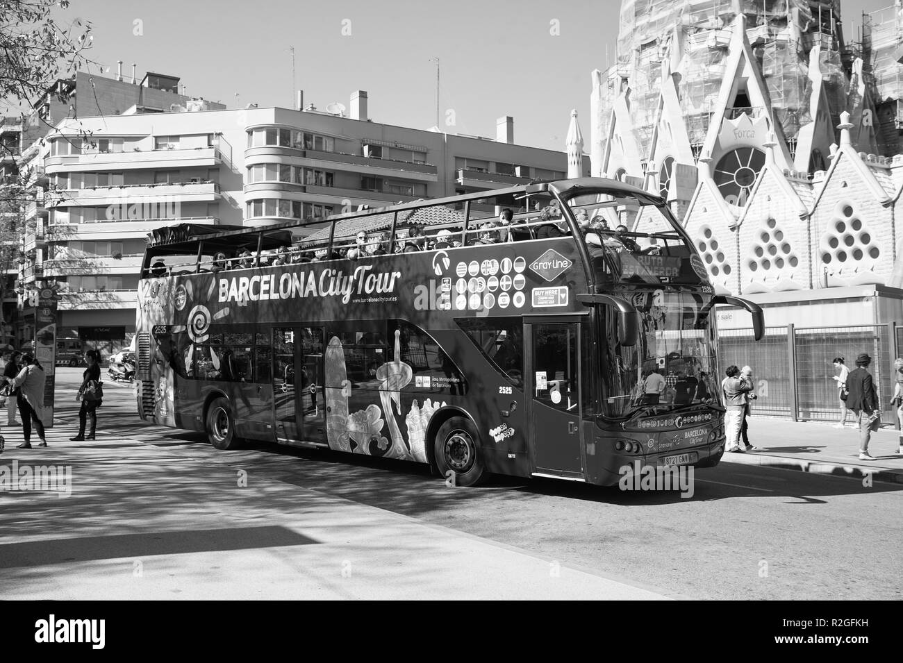 Barcelona, Spain - March 30, 2016: Barcelona city tour bus on street. Sightseeing and travelling. Transport for trip around Barcelona. Summer vacation in Barcelona. Stock Photo