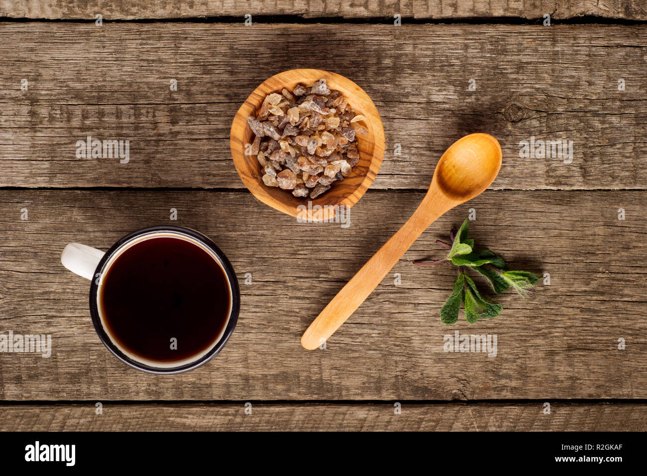 Tea cup with mint leaf and brown sugar in bowl on rustic wooden background. Copy space. Top view Stock Photo