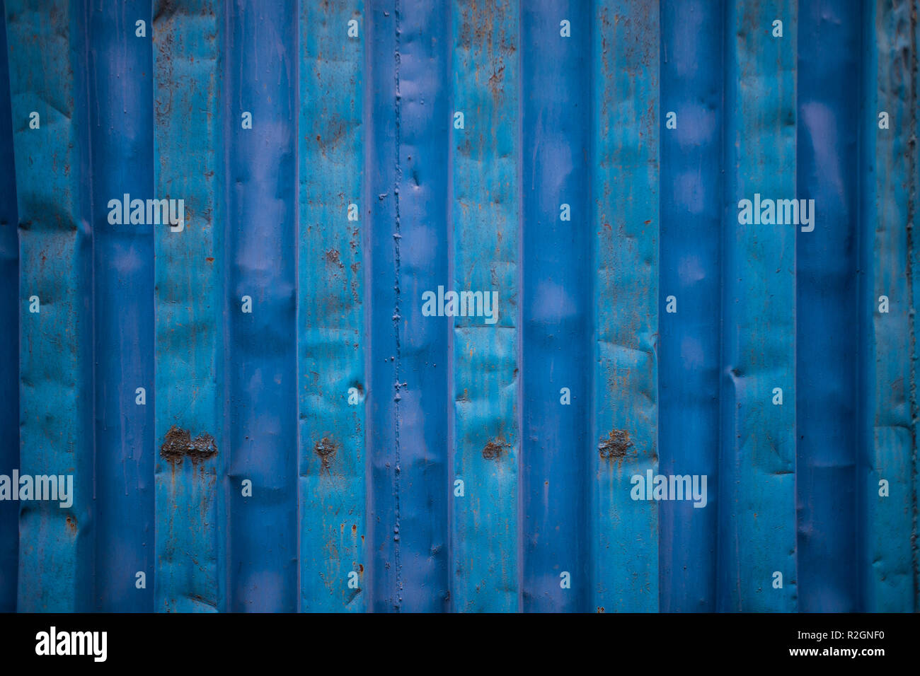 Blue cargo ship container texture close up without labels as a graphic resource - Stock Image