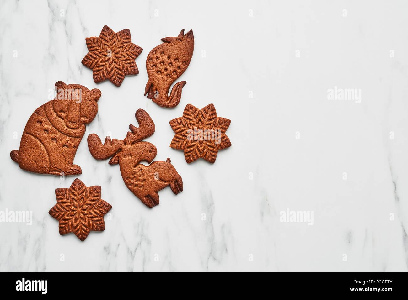 Top View Of Snowflake Bear Elk And Fox Shape Gingerbread Cookies