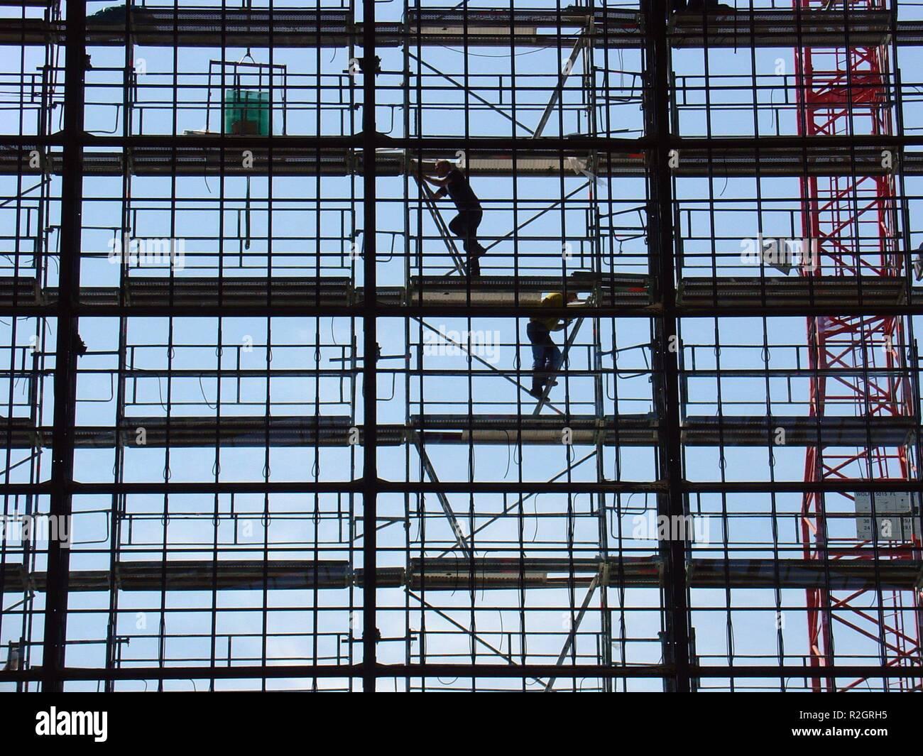 scaffolding acrobats ii - Stock Image