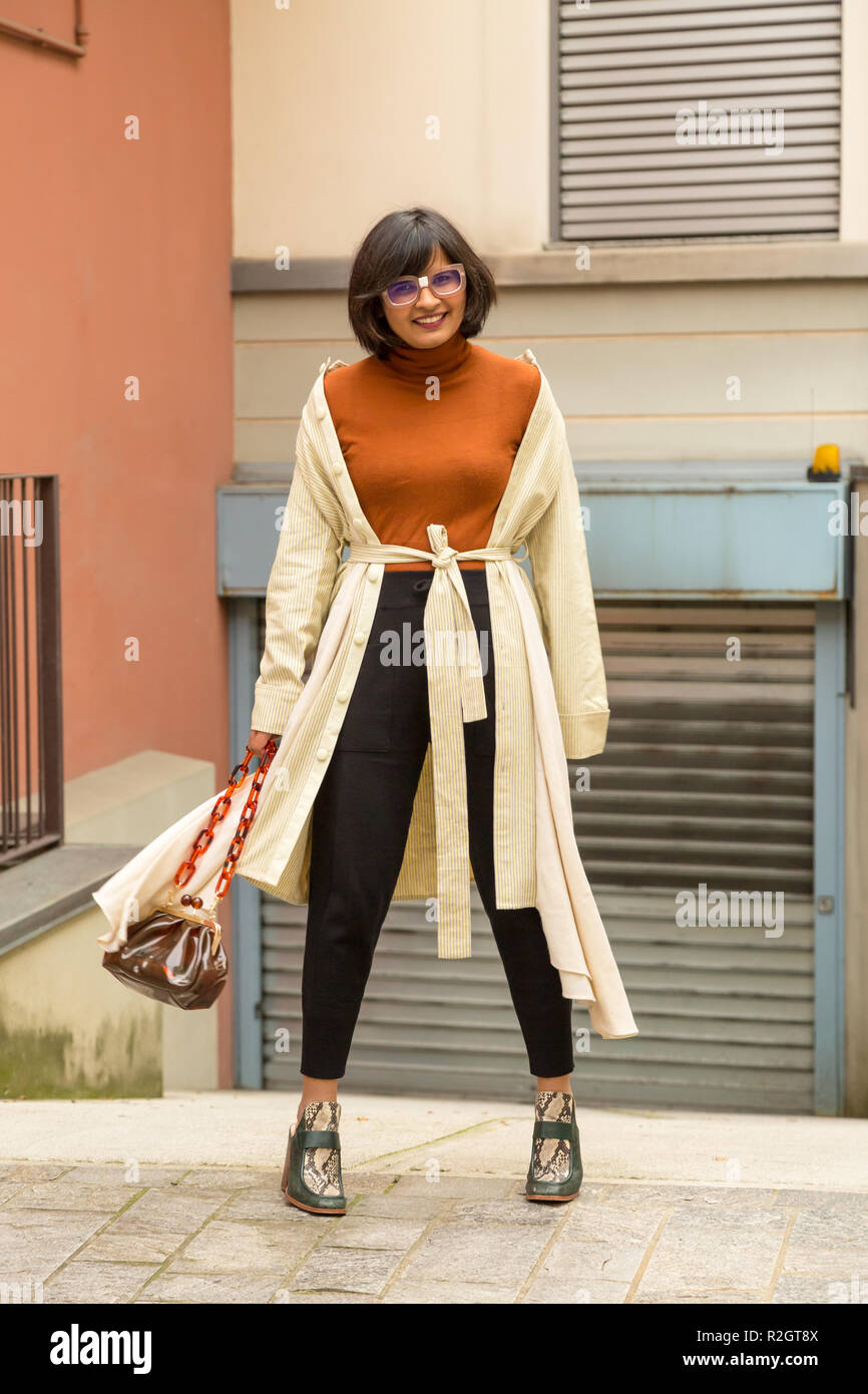 Beautiful young Indian woman posing in an urban context. Street fashion and style. - Stock Image