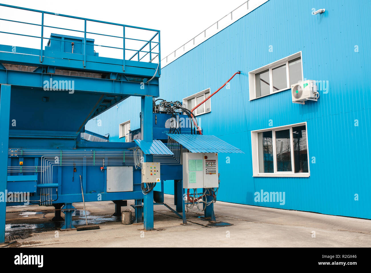 A site for loading waste into containers at a waste sorting and recycling plant. The control panel for the process of loading. - Stock Image