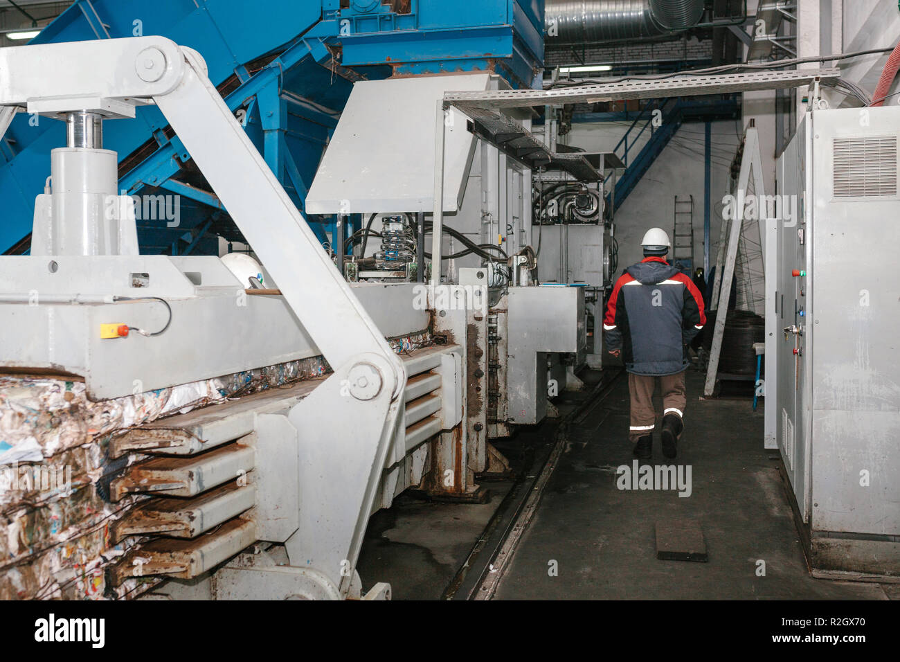 Waste processing plant. Technological process. Recycling and storage of waste for further disposal. Business for sorting and processing of waste. - Stock Image