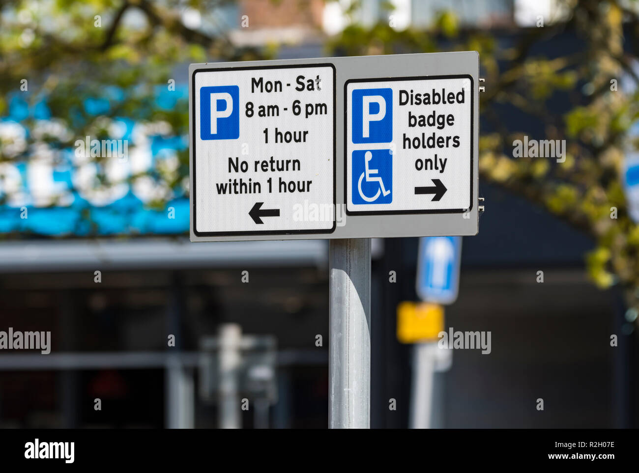 British parking restriction signs. No return within 1 hour and disabled badge holders only signs in the UK. - Stock Image