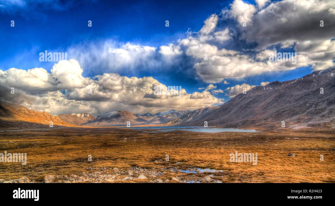 Panoramic view to lakes at Barskoon pass, river and gorge and Sarymoynak pass at Jeti-Oguz, Kyrgyzstan Stock Photo