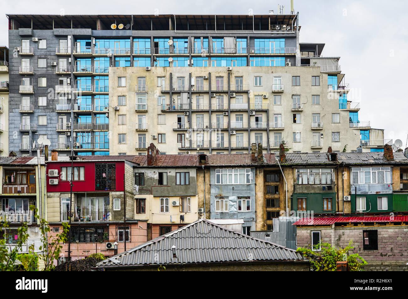 poor suburban block of flats, construction, balcony - Stock Image