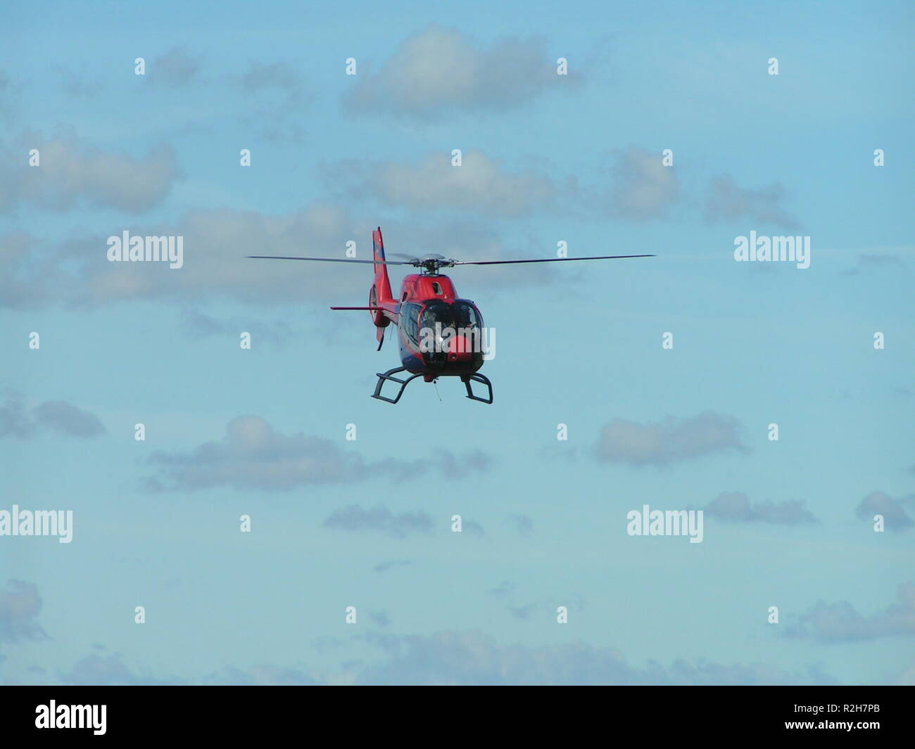red helicopter in approach Stock Photo