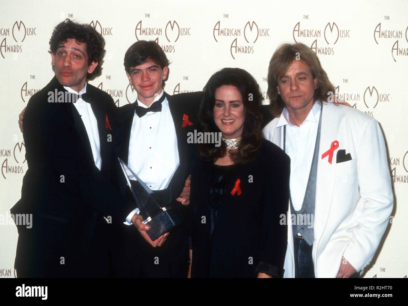 LOS ANGELES, CA - JANUARY 25: Singer Grace Slick and singer Eddie Money attend the 20th Annual American Music Awards on January 25, 1993 at the Shrine Auditorium in Los Angeles, California. Photo by Barry King/Alamy Stock Photo - Stock Image