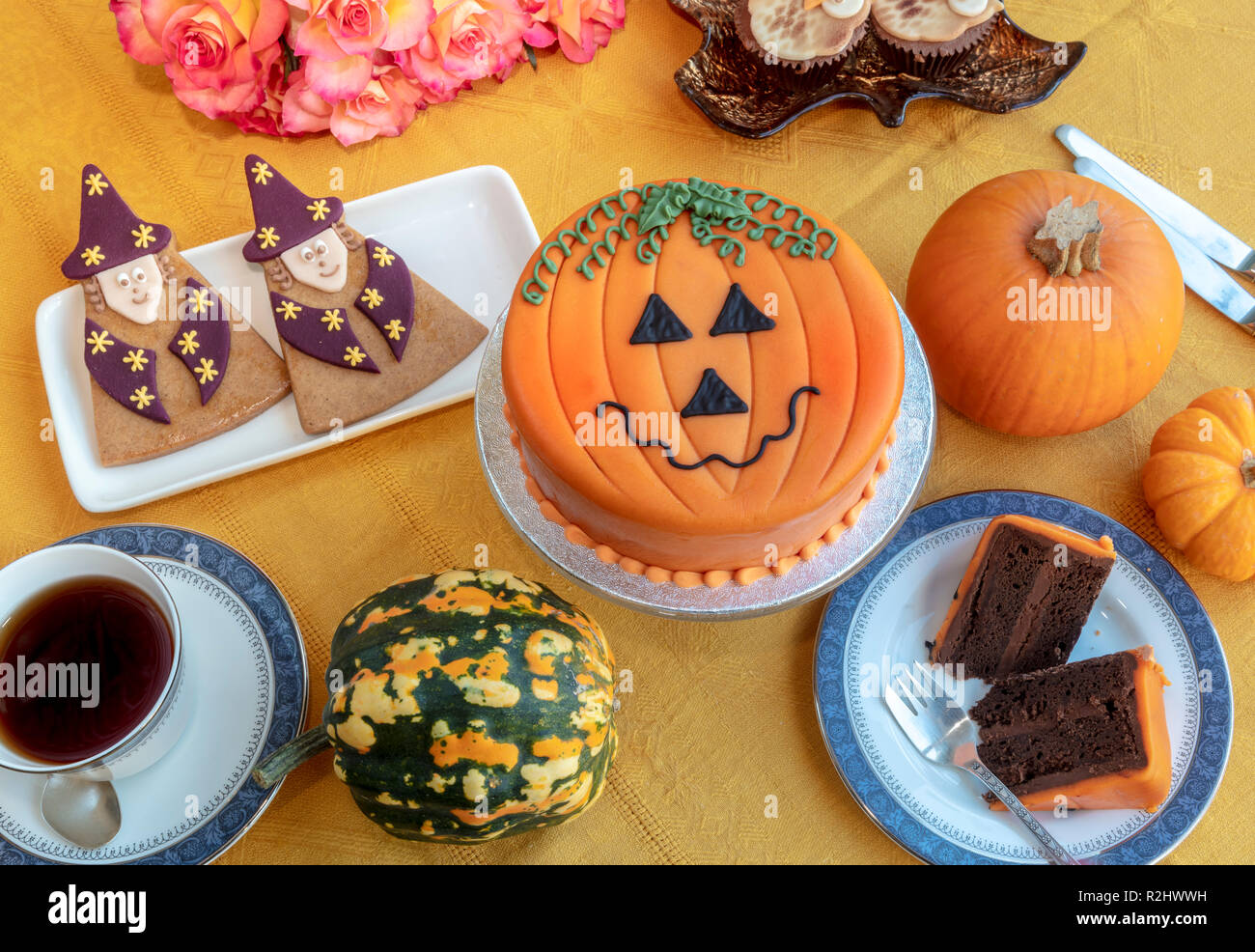 Novelty cake decorated with marzipan and icing in Halloween pumpkin theme. - Stock Image