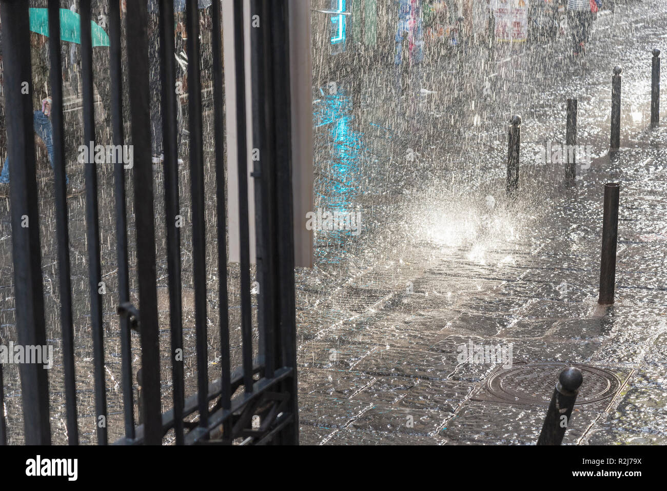 Rain, blurring and large drops of strong water flow. Blurred rain background. - Stock Image