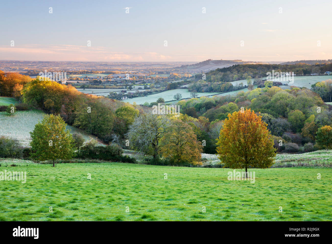 View over Meon Hill and Vale of Evesham on frosty autumn morning near Saintbury, Chipping Campden, Cotswolds, Gloucestershire, England, United Kingdom - Stock Image